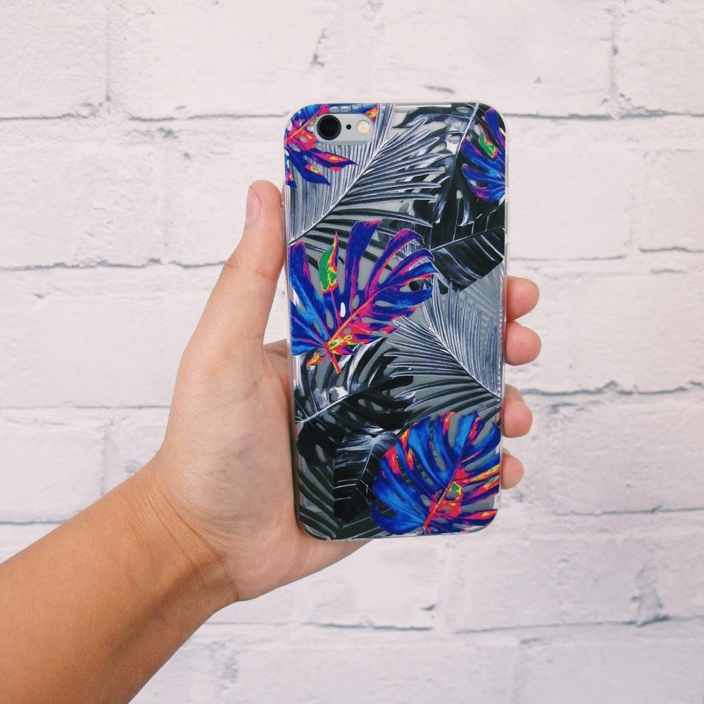 Inkase Tropical 1 Phone case held against brick wall