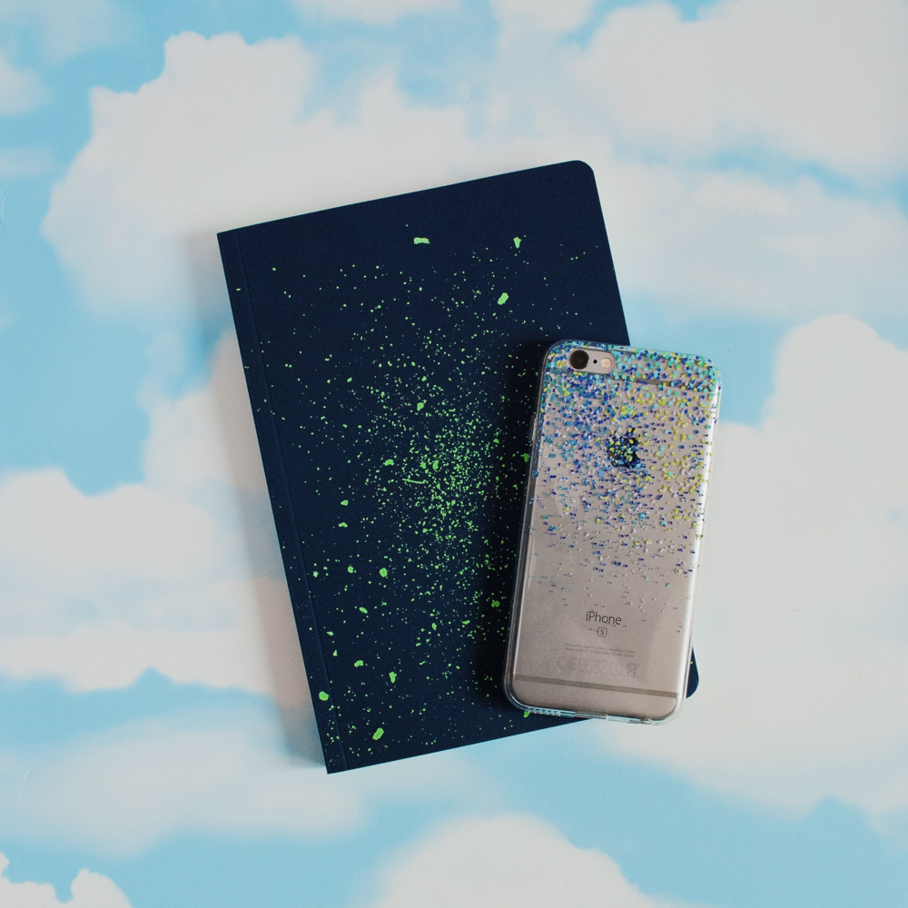 Inkase Speck 2 iPhone case on cloud background with notebook