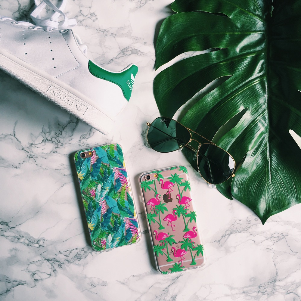Inkase Flamingo and Tropical 3 Phone Cases Flat Lay with Stan Smith Trainer