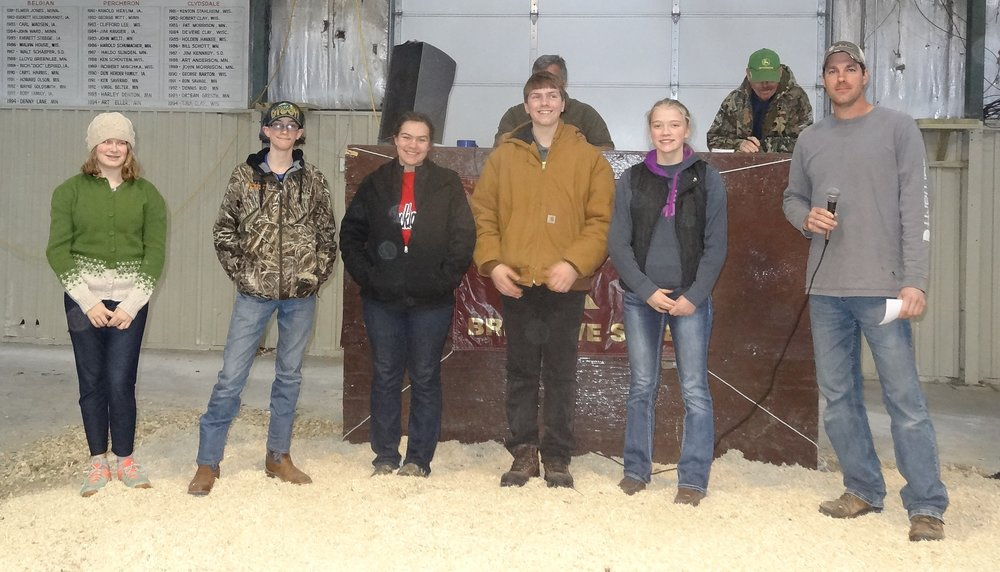 Pictured are the five MHSA scholarship winners who purchased ewes at the 2017 Minnesota Bred Ewe Sale.  From left: Ericka Lahti of Fergus Falls, MN; Zachary Carter of Starbuck, MN; Lauren Thompson of Woodville, WI; Nathan Thompson of Woodville, WI; and Elizabeth Risacher of Wright, MN. At right presenting the awards is MHSA President Rodney Scheller.