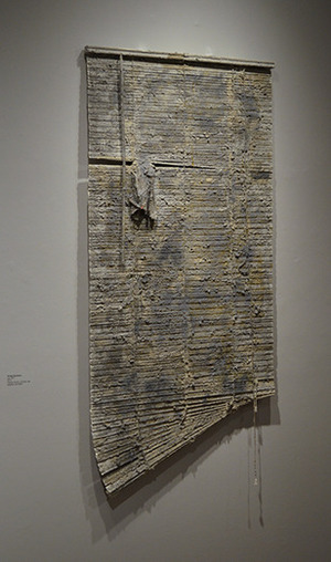 "Phillip Scarpone, Apt. #15, 2013, Venetian  blinds, rag, clay, mortar, glue, aqua resin, graphite, adhesive, fibers, 65"" x 32"" x 2"""