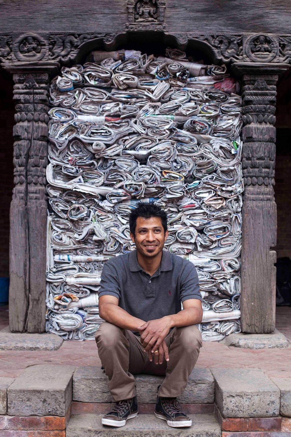 Youdhi Maharjan in front of his installation featured in the First Kathmandu Triennial