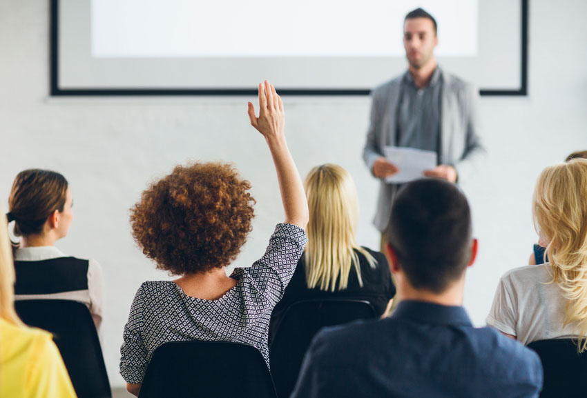 Employee taking part in a corporate wellbeing workshop with Work Well Being.jpg