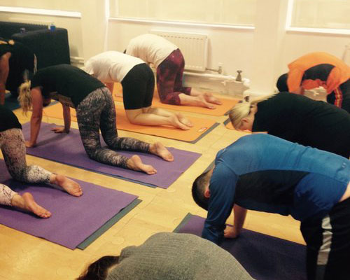 Yoga class for employees in the workplace to improve wellbeing.jpg