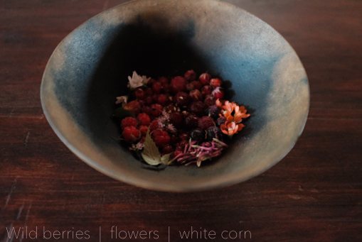 Wild berries | flowers | white corn meal (Johnny speaking)  This dish is a great example of the fleeting nature of time. 7 or so wild berries, mountain strawberries, mountain raspberries, bear berries, chokecherries, wax currant, wild plum, gooseberry. With flowers from the land we live on and a sauce made of white corn and three leaf sumac berry. (Due to the brief peak season of these ingredients) we were only able to serve this dish to two or three dinners.