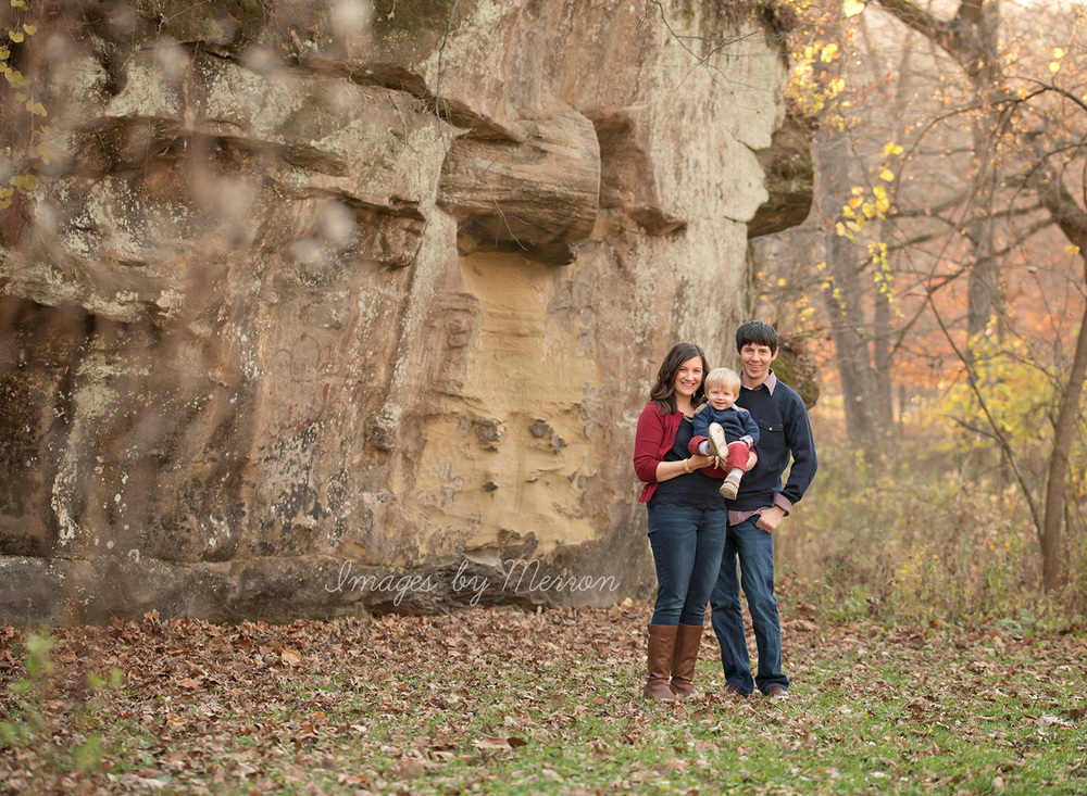Family in front of large stone walls at park