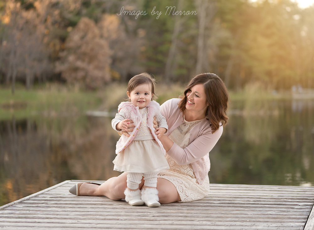 Mommy and baby girl posing in pastel pink