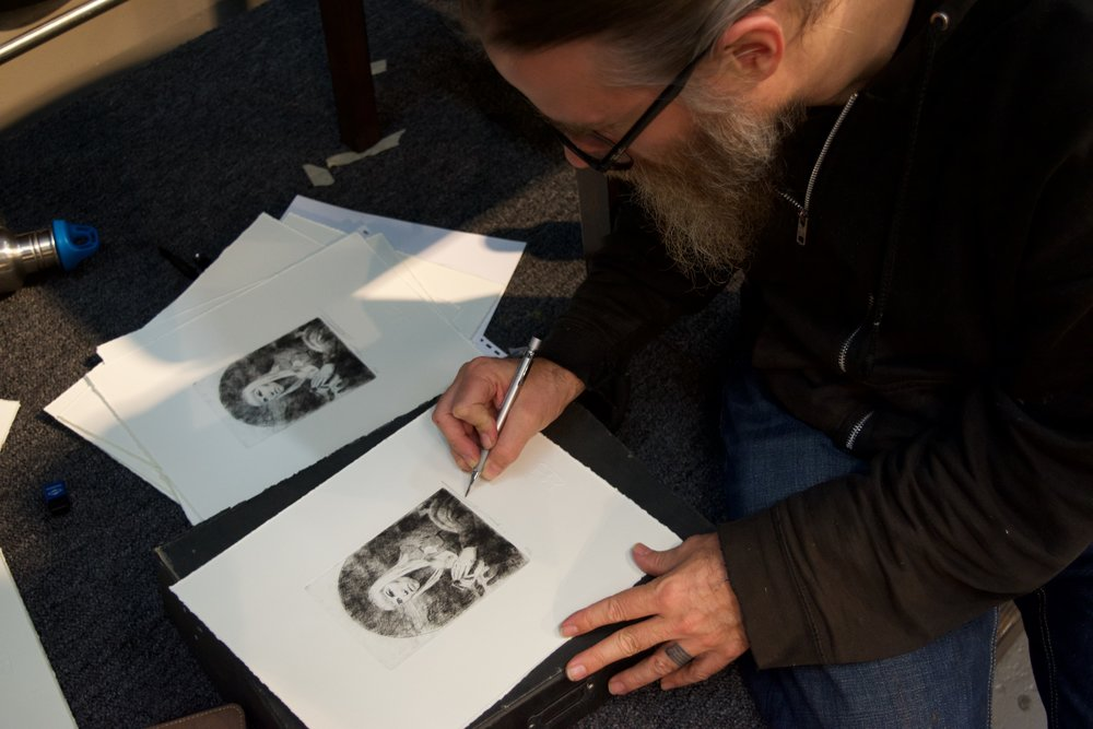 "Artist Carl Dobsky Signs His ""i-prayer"" Etching - Fall 2015"