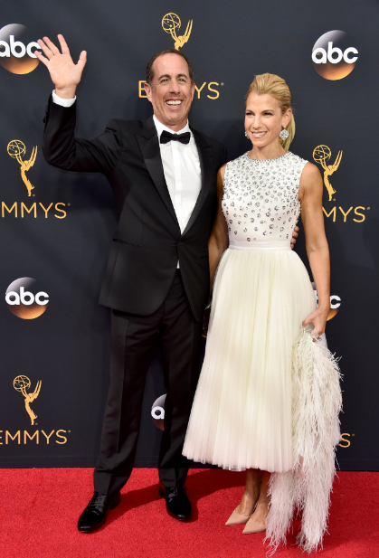 Jerry Seinfeld, left and Jessica Seinfeld, who's wearing Dior. Alberto E. Rodriguez/ Getty Images