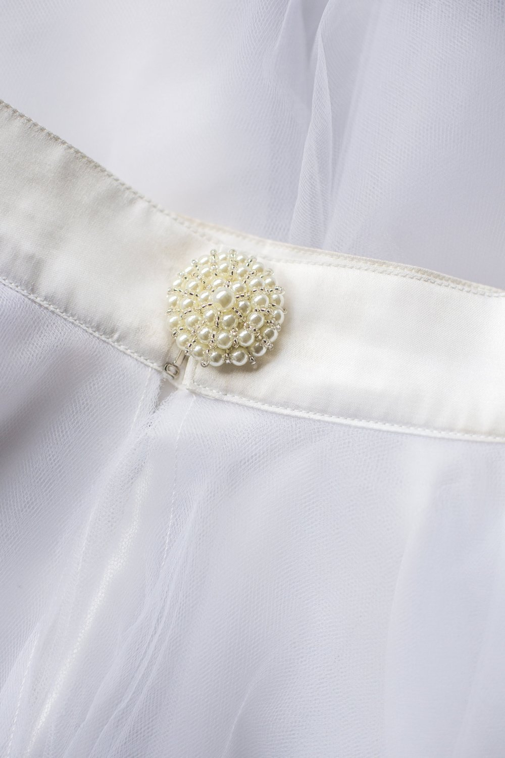 Tutu Moi Pearl Button Closure Detail
