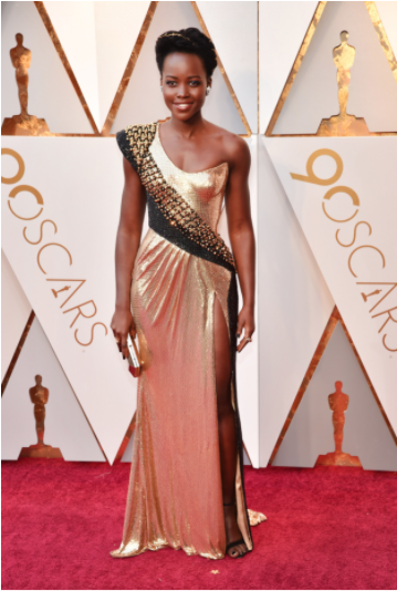 Lupita Nyong'o in custom Atelier Versace, Alexandre Birman shoes, Niwaka jewelry, and with a Versace bag, Vogue.com