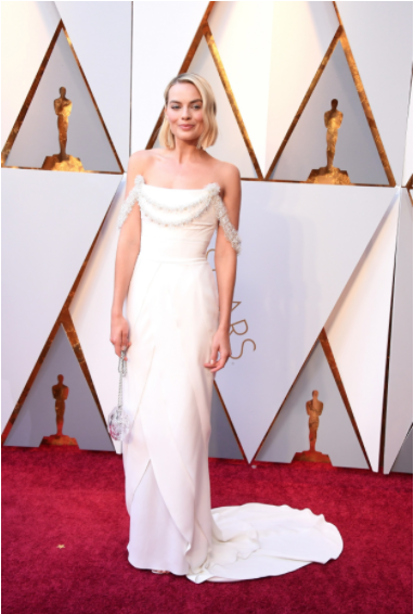 Margot Robbie in Chanel Haute Couture and Roger Vivier shoes, Vogue.com