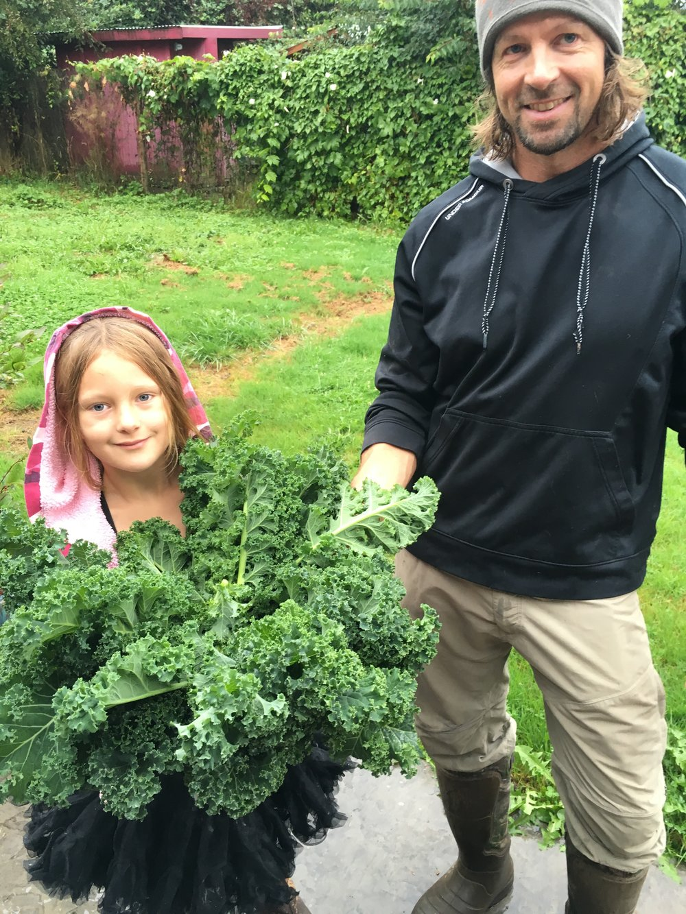 Ryan and Pailey after a kale harvest.