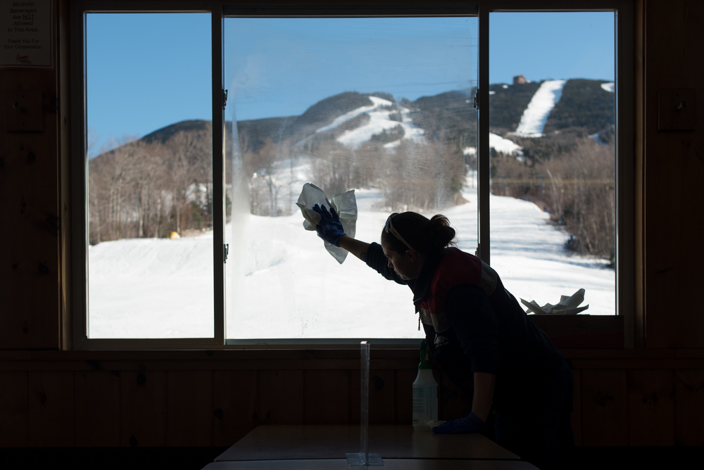 Malena Spreadbury, a part-time employee at Cannon cleans the Notchview Lodge window on Saturday, Mar. 19, 2016.