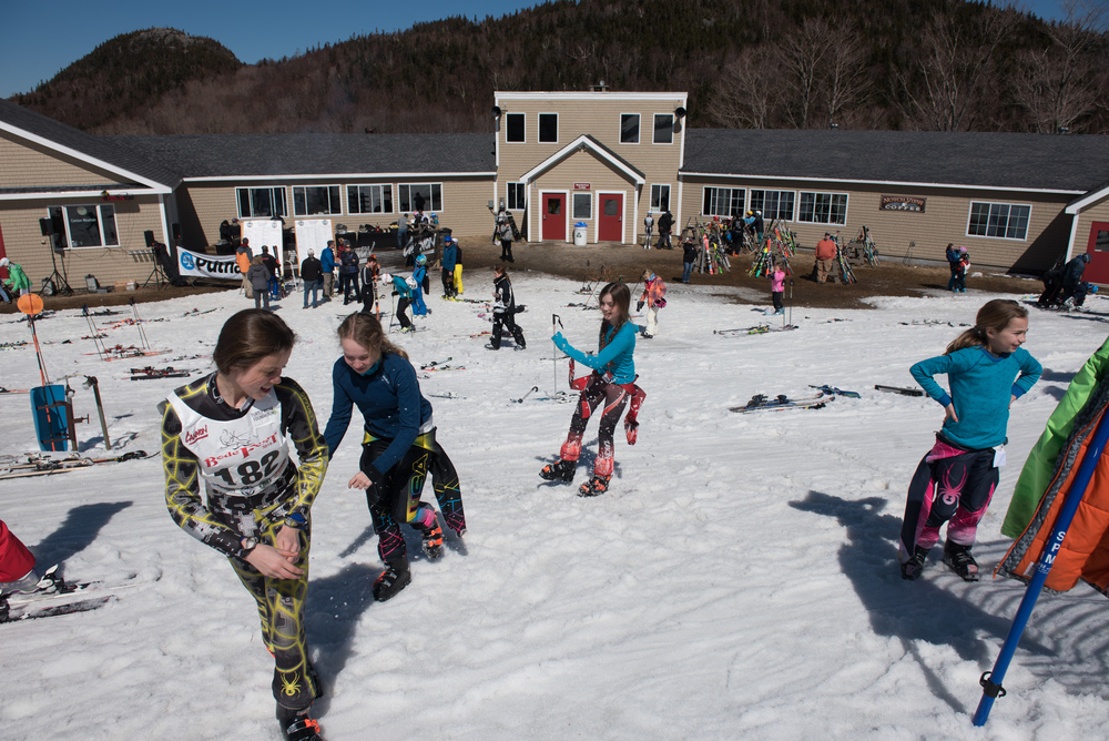 Young racers kick snow at each other at the bottom of the race hill during Bodefest, a charity event put on by the Turtle Ridge Foundation in honor of Olympic skier and Franconia native Bode Miller at Cannon Mountain on Saturday, Mar. 26, 2016.