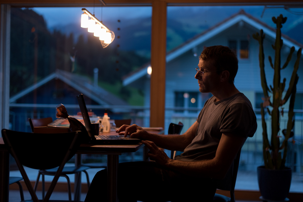 8/10/16 – Frutigen, Bern – Peter works on a technical document in his kitchen in Frutigen during my trip to Switzerland on Wednesday, Aug. 10, 2016. (Photo by Nicholas Pfosi)
