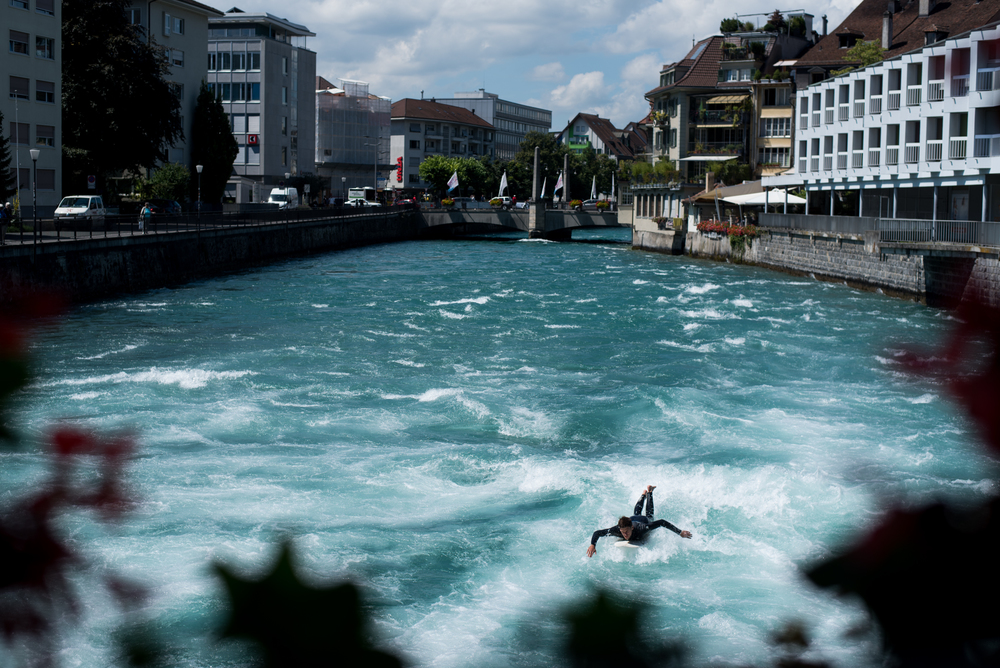 8/11/16 – Thun, Bern – A man surfs on a river in Thun in Switzerland on Thursday, Aug. 11, 2016. (Photo by Nicholas Pfosi)