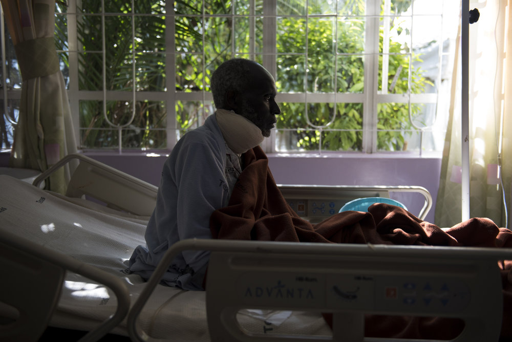 8/23/15 – Nairobi, Kenya – Samwell Mosota Omaiyo sits up in his bed on Sunday afternoon at the Texas Cancer Center in patient facility in Nairobi, Kenya on Sunday, Aug. 23, 2015. Nurses here are trained in palliative care and give round the clock care to over a dozen patients in this small medical building. (Photo by Nicholas Pfosi)