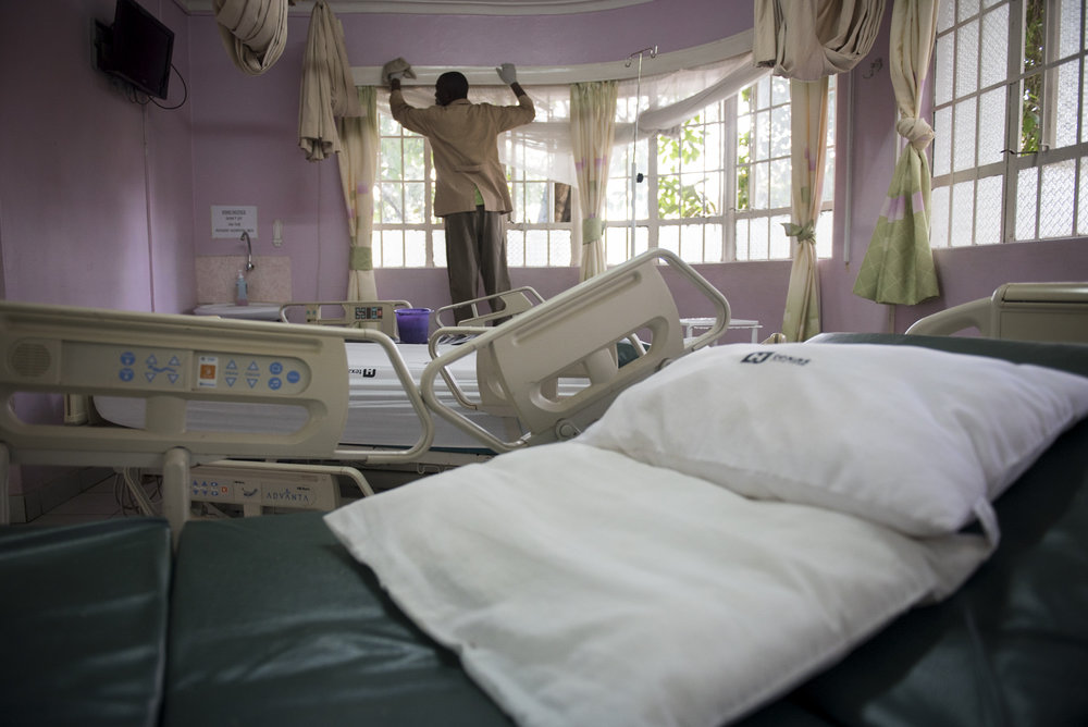 8/25/15 – Nairobi, Kenya – A man cleans a patient's room following his discharge from the Texas Cancer Center in patient facility in Nairobi, Kenya on Tuesday, Aug. 25, 2015. Nurses here are trained in palliative care and give round the clock care to over a dozen patients in this small medical building. (Photo by Nicholas Pfosi)