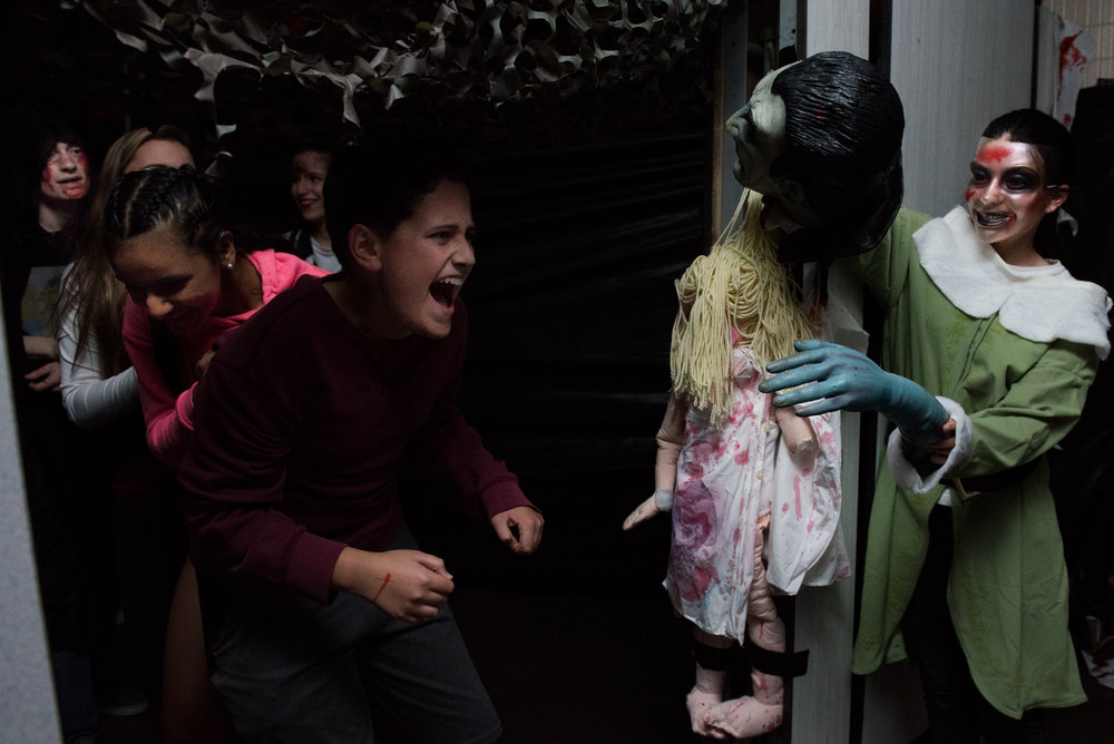 10/26/16 – Belmont, MA – Guests jump back in fear during the third annual Belmont High School Haunted House which raises money for the Saint Rock Haiti Foundation at Belmont High School on Wednesday, Oct. 26, 2016. (Photo by Nicholas Pfosi)