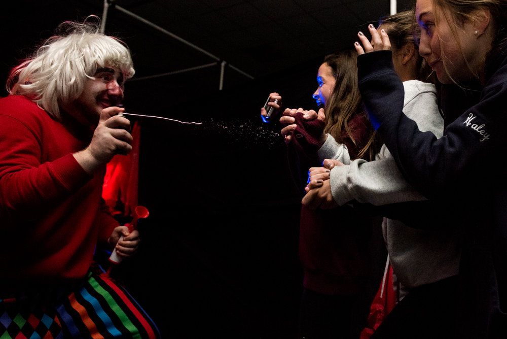 10/26/16 – Belmont, MA – Guests jump back in fear from senior David Korn, left, during the third annual Belmont High School Haunted House which raises money for the Saint Rock Haiti Foundation at Belmont High School on Wednesday, Oct. 26, 2016. (Photo by Nicholas Pfosi)