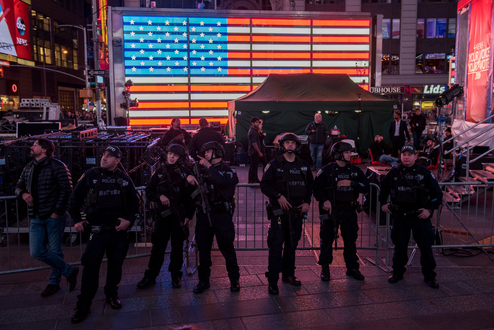 11/8/16 – New York City, MA – Anti-terrorism police officers stand against a barricade in Times Square during Donald Trump's surprising presidential victory in Times Square, Manhattan in New York City on Tuesday, Nov. 8, 2016. Following a tumultuous and unusual campaign, candidate Donald Trump surpassed career politician Hilary Clinton in a tight and long election day, with the announcement coming at around 3 o'clock in the morning. (Photo by Nicholas Pfosi)