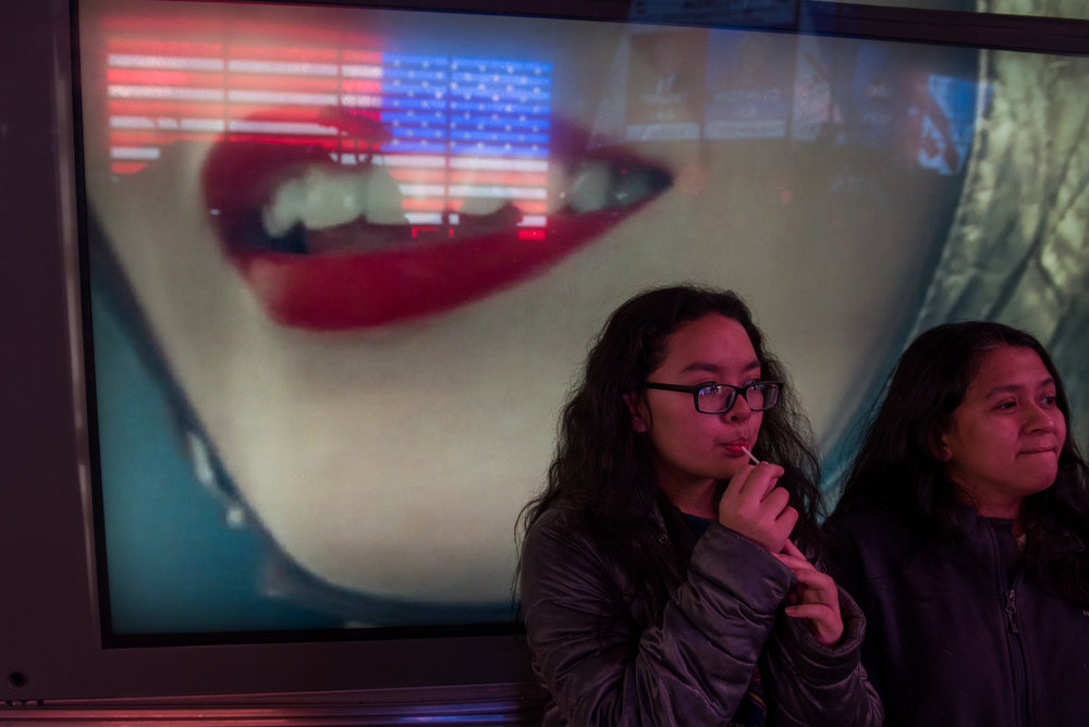 11/8/16 – New York City, MA – A woman and her daughter who declined to be identified watch the election news coverage during Donald Trump's surprising presidential victory in Times Square, Manhattan in New York City on Tuesday, Nov. 8, 2016. Following a tumultuous and unusual campaign, candidate Donald Trump surpassed career politician Hilary Clinton in a tight and long election day, with the announcement coming at around 3 o'clock in the morning. (Photo by Nicholas Pfosi)