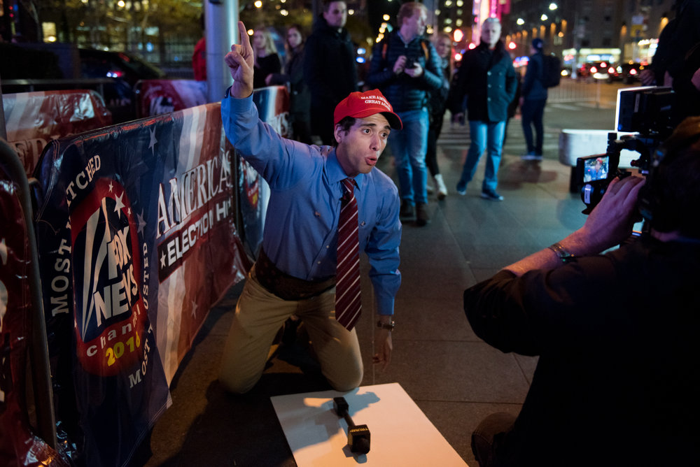 """11/8/16 – New York City, MA – A man who only identified himself as """"Trump Guy"""" - Donald Trump's """"biggest supporter"""" - performs absurd anti-Trump speeches for a news camera during Donald Trump's surprising presidential victory outside News Corp where Fox News was recording live in Manhattan, New York City on Tuesday, Nov. 8, 2016. Following a tumultuous and unusual campaign, candidate Donald Trump surpassed career politician Hilary Clinton in a tight and long election day, with the announcement coming at around 3 o'clock in the morning. (Photo by Nicholas Pfosi)"""