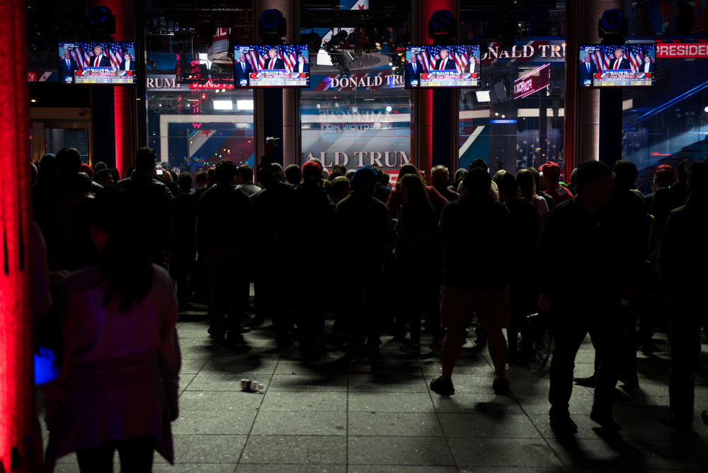 11/9/16 – New York City, MA – Trump supporters celebrate together during Donald Trump's surprising presidential victory outside News Corp where Fox News was recording live in Manhattan, New York City on Wednesday, Nov. 9, 2016. Following a tumultuous and unusual campaign, candidate Donald Trump surpassed career politician Hilary Clinton in a tight and long election day, with the announcement coming at around 3 o'clock in the morning. (Photo by Nicholas Pfosi)