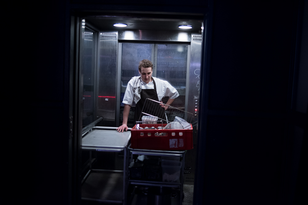 """2/19/17 – Aarhus, Nordjylland – Andor Füzi, a student studying marketing in Aarhus, works his day job at the Clemens Gastro og Bar in downtown Aarhus on Sunday, Feb. 19, 2017. Füzi is pursuing an associates degree, followed by a bachelors here in Denmark, but has a passion for DJ'ing. About mixing music he said it gives him freedom. """"When I DJ I don't think about any of my problems - it's just me, the music and the crowd."""" (Photo by Nicholas Pfosi)"""