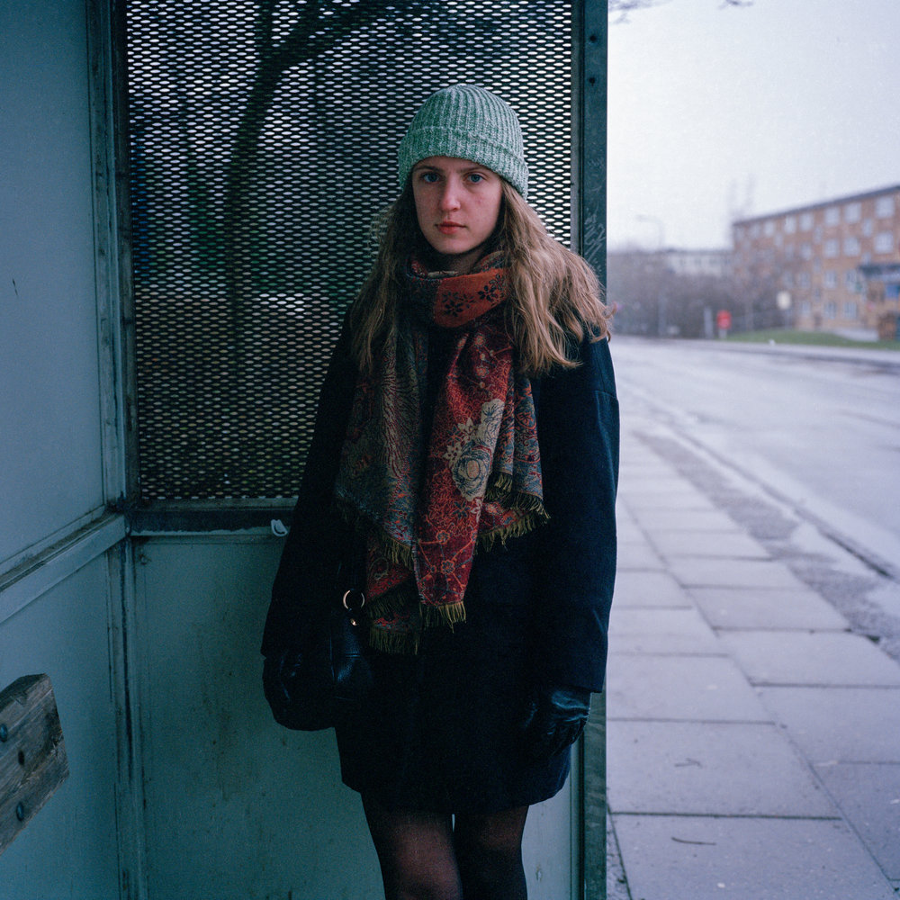 3/19/17 – Aarhus, Nordjylland – Capucine poses for a portrait at the Emmasvej bus stop on Sunday, Mar. 19, 2017. (Photo by Nicholas Pfosi)This photo was made with Kodak Portra 400 120 film using a Mamiya 6x6 medium format camera borrowed from DMJX as part of a project on LGBT refugees. This image was part of a test roll to evaluate the limitations of the film.