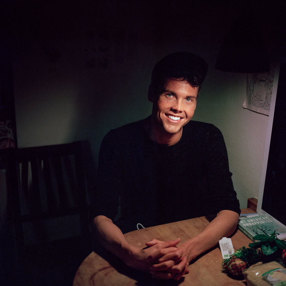3/19/17 – Aarhus, Nordjylland – Cj poses for a portrait in my kitchen on Sunday, Mar. 19, 2017. (Photo by Nicholas Pfosi)This photo was made with Kodak Portra 400 120 film using a Mamiya 6x6 medium format camera borrowed from DMJX as part of a project on LGBT refugees. This image was part of a test roll to evaluate the limitations of the film.