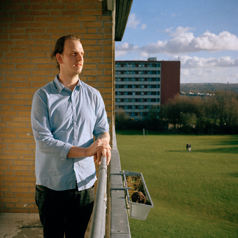 3/18/17 – Aarhus, Nordjylland – Morten, Wilma's friend from DMJX poses for a portrait on my balcony on Saturday, Mar. 18, 2017. (Photo by Nicholas Pfosi)This photo was made with Kodak Portra 400 120 film using a Mamiya 6x6 medium format camera borrowed from DMJX as part of a project on LGBT refugees. This image was part of a test roll to evaluate the limitations of the film.