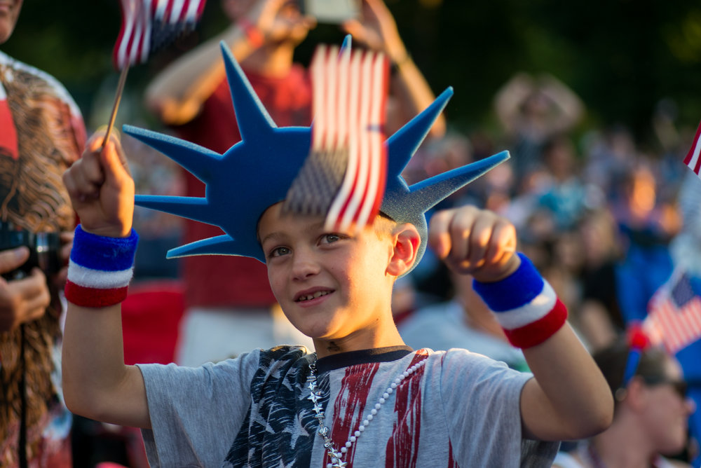 Boston, MA - 7/4/17 - Jackson Ali waves American flags during the Fourth of July Pops celebration on the Esplanade on Tuesday, July 4, 2017. (Nicholas Pfosi for The Boston Globe) Topic: 05IndepenceDaypic