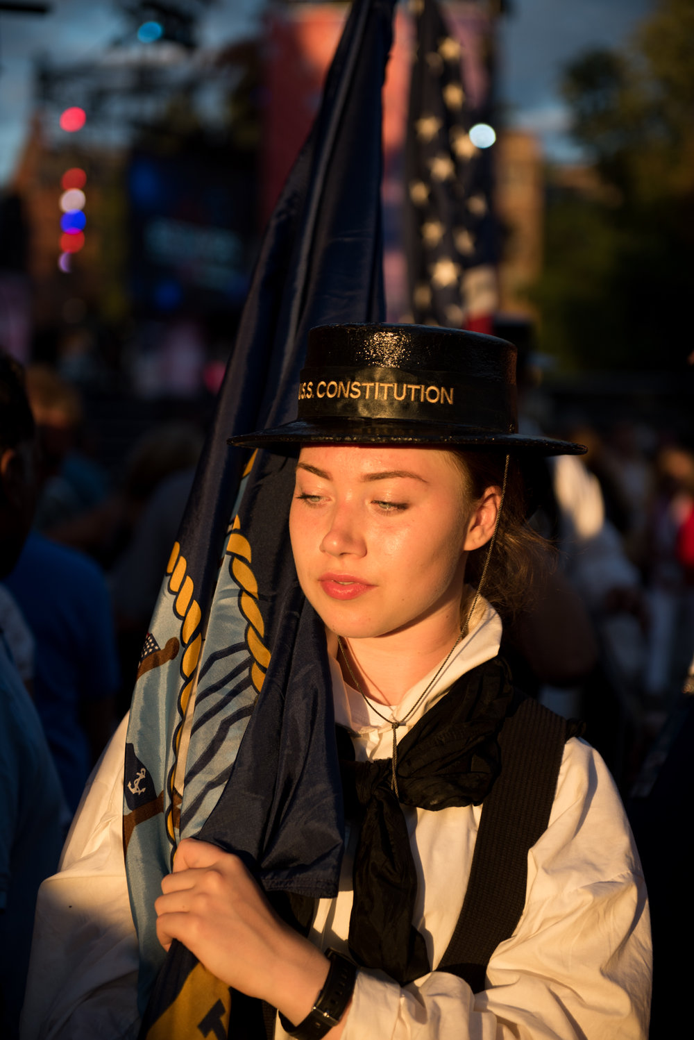 Boston, MA - 7/4/17 - Sydney Donovan, an active duty Navy sailor on the USS Constitution carries out a flag during the Fourth of July Pops celebration on the Esplanade on Tuesday, July 4, 2017. (Nicholas Pfosi for The Boston Globe) Topic: 05IndepenceDaypic