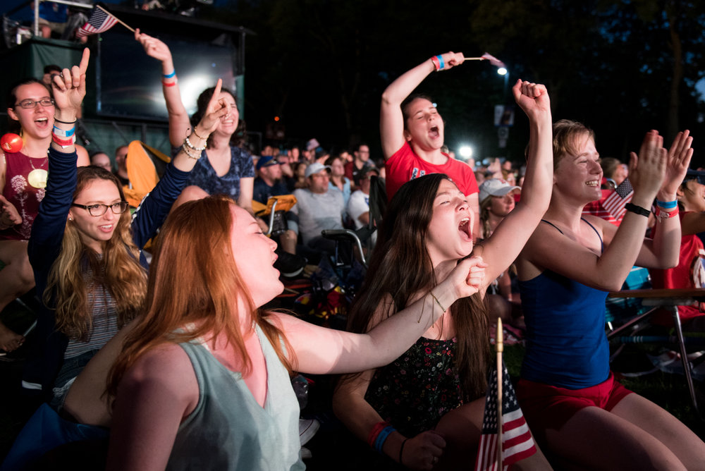 Boston, MA - 7/4/17 - From left to right, Erin McNamara, Danielle Morency, and Jennifer Ives and their friends celebrate Melissa Etheridge during the Fourth of July Pops celebration on the Esplanade on Tuesday, July 4, 2017. (Nicholas Pfosi for The Boston Globe) Topic: 05IndepenceDaypic