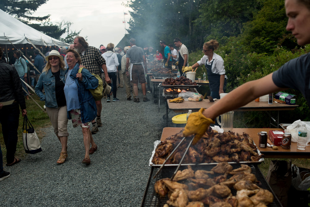 Brooklin, ME - 8/5/17 - The evening dinner during the Eggemoggin Reach Regatta after party on the the Wooden Boat School grounds on Saturday, August 5, 2017. The Conover clan has come together for years to race in the Eggemoggin Reach Regatta. (Nicholas Pfosi for The Boston Globe) Reporter: Bethany Ao Topic: woodenboatEmma Conover, 23; tall, skinny, often wear hatsEthan Andrus, 15; Jen's son, long hair, often has headband, biked downJen Conover; mother, biked downLydia Morin, 20; niece of Jen, biked down, has straw hat on SinbadDee Dee Conover, 82; 82 years oldElli Andrus, 12; Ethan's sister; youngest, blonde hairSimon Morin, 18; Lydia's brother, longer hair, tallCedar Andrus; not a lot of photos of him, blonde hair, shorterWill Conover, 21; tallest, Peace Corps guy, curly hair