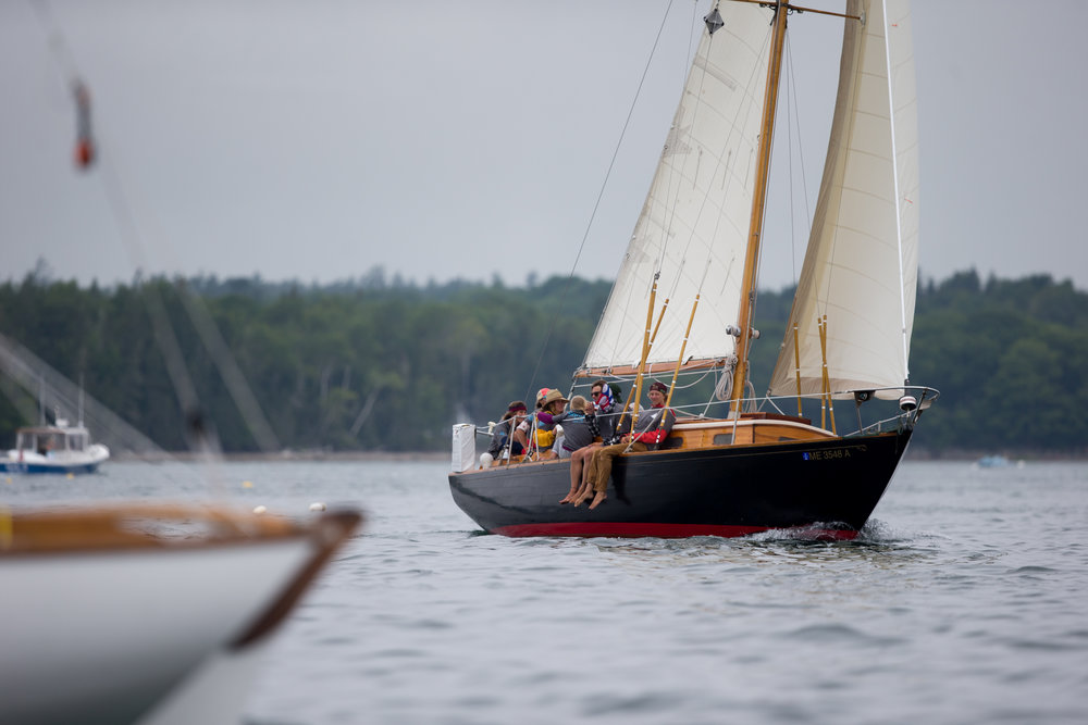 Brooklin, ME - 8/5/17 - Sinbad during the Eggemoggin Reach Regatta on Saturday, August 5, 2017. The Conover clan has come together for years to race in the Eggemoggin Reach Regatta. (Nicholas Pfosi for The Boston Globe) Reporter: Bethany Ao Topic: woodenboatEmma Conover, 23; tall, skinny, often wear hatsEthan Andrus, 15; Jen's son, long hair, often has headband, biked downJen Conover; mother, biked downLydia Morin, 20; niece of Jen, biked down, has straw hat on SinbadDee Dee Conover, 82; 82 years oldElli Andrus, 12; Ethan's sister; youngest, blonde hairSimon Morin, 18; Lydia's brother, longer hair, tallCedar Andrus; not a lot of photos of him, blonde hair, shorterWill Conover, 21; tallest, Peace Corps guy, curly hair