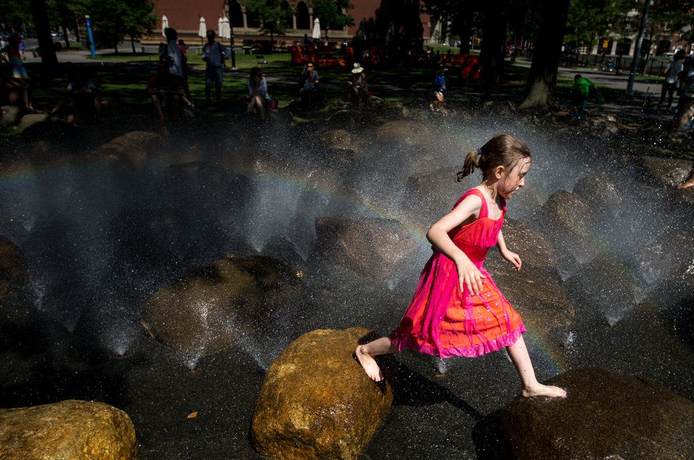 Cambridge, MA - 7/2/17 - Brynn Saltsman, 7, plays in the Harvard Science Center fountain while visiting the Harvard Museum of Natural History from her hometown of Ashburnham, Mass., with her family in Harvard Square on Sunday, July 2, 2017. (Nicholas Pfosi for The Boston Globe)