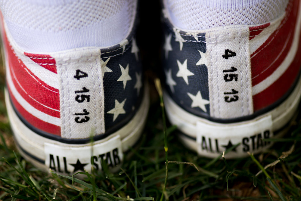 Boston, MA - 7/4/17 - Ritajayne Rivera, with American themed sneakers with the date of the Boston Marathon bombing written on them during the Fourth of July Pops celebration on the Esplanade on Tuesday, July 4, 2017. Rivera was near the first bomb during marathon. (Nicholas Pfosi for The Boston Globe) Topic: 05IndepenceDaypic