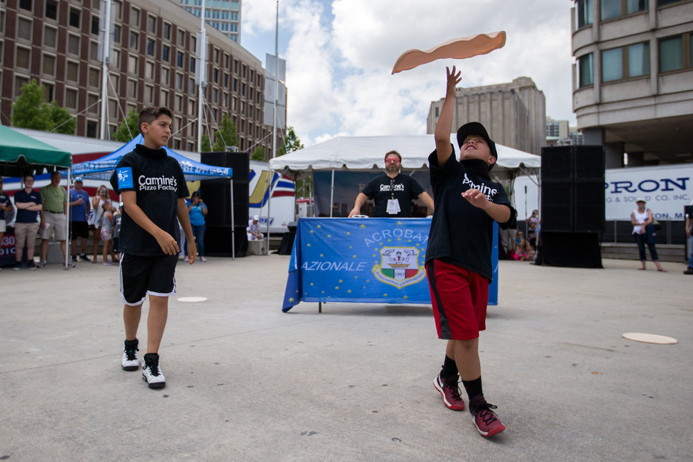 Boston, MA - 7/8/17 - Michael and is younger brother Nicholas Testa, the duo comprising the Jersey Pizza Boys, a viral video sensation from New Jersey, perform during the first annual Boston Pizza Festival at City Hall Plaza in downtown Boston on Saturday, July 8, 2017. Five years ago Michael made a video that went viral and the duo has since appeared on national television including Late Night with Jimmy Falon. The Boston Pizza festival is a two-day event giving local pizzerias the opportunity to show-off their pizzas and visitors the chance to learn more about pizza making. (Nicholas Pfosi for The Boston Globe) Topic: 09pizzafestival