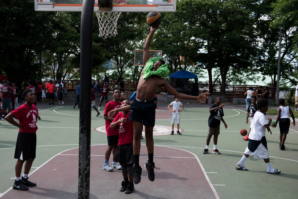 Roxbury, MA - 7/8/17 - Hassan Bakerr, of Dorchester, jumps for the basket during the Save R Streets Summer Classic basketball tournament at Jeep Jones Park in Roxbury, Mass., on Saturday, July 8, 2017. The event follows a recent uptick in violence in the area following the July 4th holiday weekend. (Nicholas Pfosi for The Boston Globe) Reporter: Allana Barefield Topic: 09peace