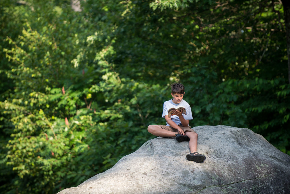Orford, NH - 7/18/17 - John Robins reads in the morning during a sunny morning at Camp Moosilauke on Tuesday, July 18, 2017. Camp Moosilauke is the oldest continually operated camp in New Hampshire, founded in 1904. (Nicholas Pfosi for The Boston Globe) Reporter: Tom Farragher Topic: 19Farragher