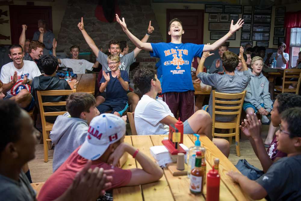 Orford, NH - 7/17/17 - Lucas Raskin, who was telling a joke, celebrates the return of the power during a rainy afternoon at Camp Moosilauke on Monday, July 17, 2017. Because of the weather, the power was temporarily knocked out but campers continued on with flash lights, hardly missing a beat. (Nicholas Pfosi for The Boston Globe) Reporter: Tom Farragher Topic: 19Farragher