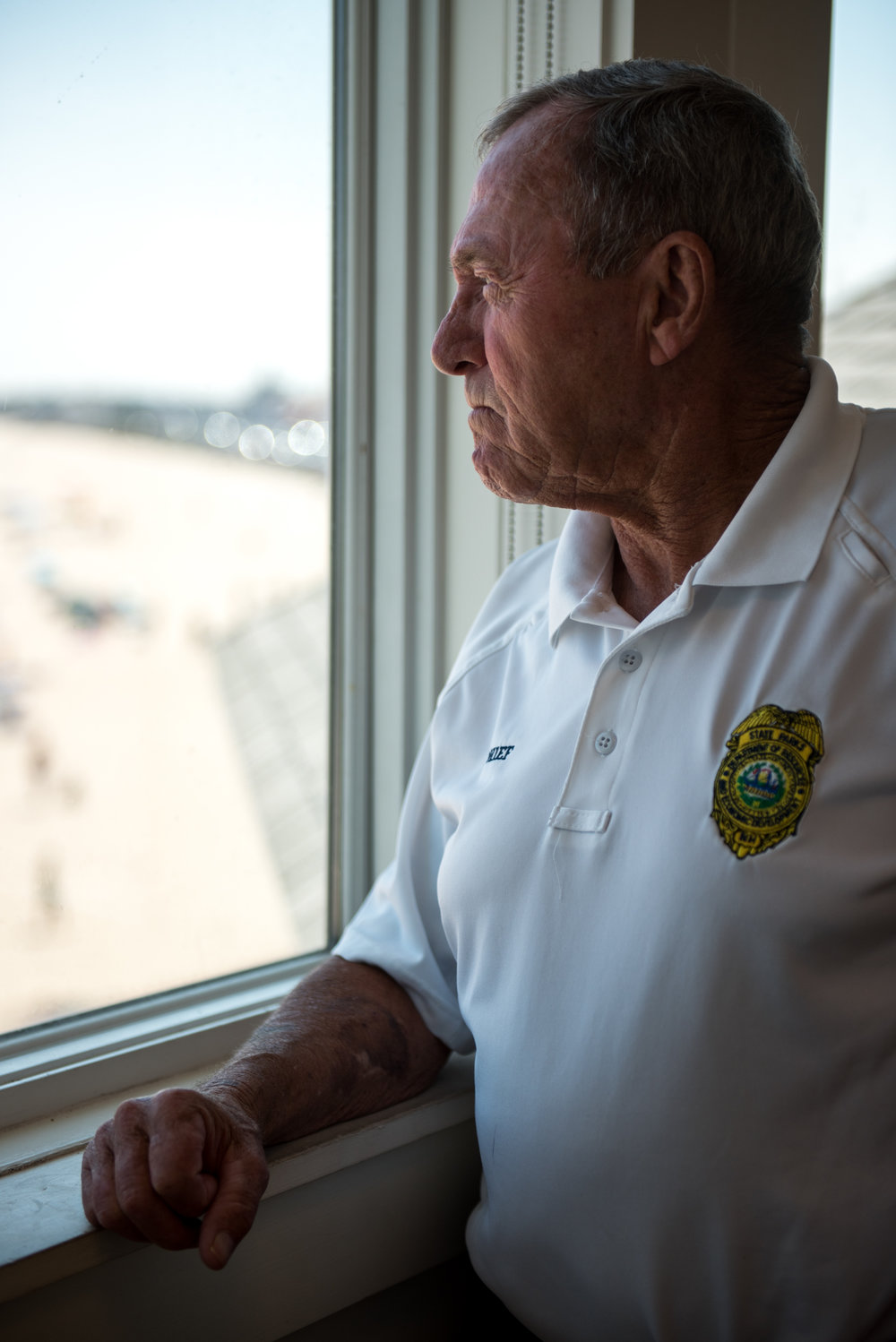 Hampton, NH - 7/21/17 - Chief of Lifeguards,James Donahue looks out for rip tides during a sunny Friday afternoon at Hampton Beach on Friday, July 21, 2017. Early this week dozens of rescues occurred due to strong rip tides, an unusually high number. (Nicholas Pfosi for The Boston Globe) Reporter: Billy Baker Topic: 22rescues(2)