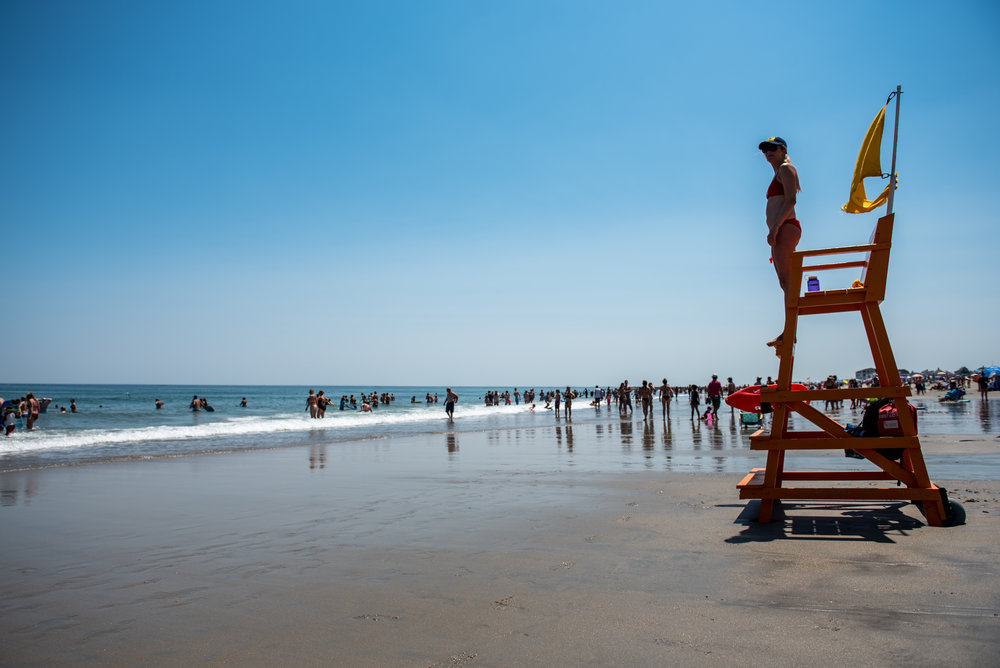 Hampton, NH - 7/21/17 - A lifeguard who declined to be identified surveys the beach during a sunny Friday afternoon at Hampton Beach on Friday, July 21, 2017. Early this week dozens of rescues occurred due to strong rip tides, an unusually high number. (Nicholas Pfosi for The Boston Globe) Reporter: Billy Baker Topic: 22rescues(2)