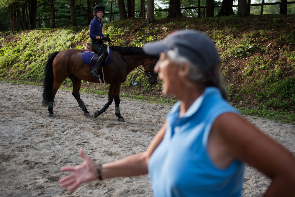 Sherburn, MA - 7/28/17 - Emily Martin, a Walpole high school graduate, who is competing in the Milbrook Horse Trials, practices with her horse, Polson, her trainer Stephanie Baer at the Long Run Farm on Friday, July 28, 2017. (Nicholas Pfosi for The Boston Globe) Reporter: Katherine Fominykh  Topic: 06soequestrian