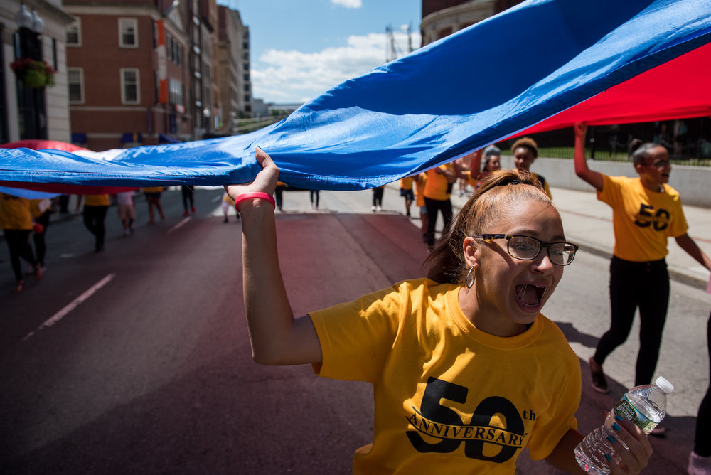 Boston, MA - 7/30/17 - Kayleen Aponte (cq) chants during the 50th annual grand parade of the Puerto Rican Festival of Massachusetts which marched from the Hynes Convention Center to City Hall Plaza on Sunday, July 30, 2017. The festival began in 1967 as a one-day event attracting 2500 people and is now three days with crowds upwards of 150,000, as the largest Hispanic festival in New England. (Nicholas Pfosi for The Boston Globe) Topic: 31puertorican(2)