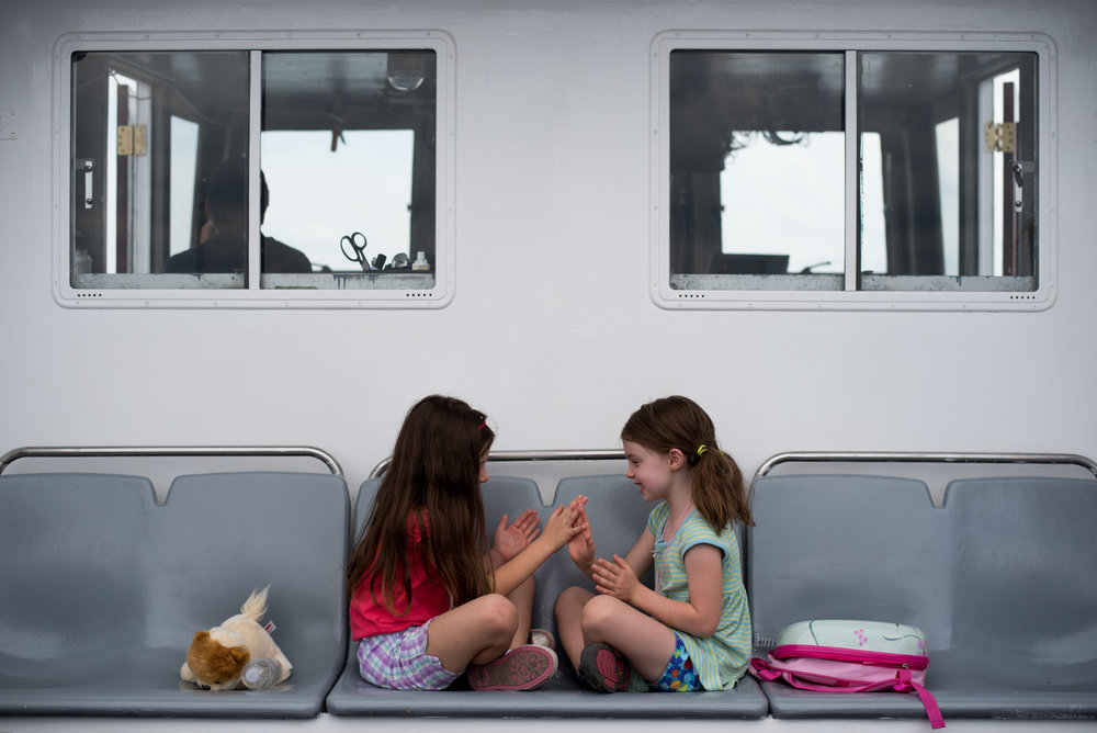 Boston, MA - 8/15/17 - Jackie Pratt, 6, left, from Vienna, Virginia, and Adele Giaccai, 6, right, from Washington D.C. play together on the ferry to George's Island on Tuesday, August 15, 2017. (Nicholas Pfosi for The Boston Globe)