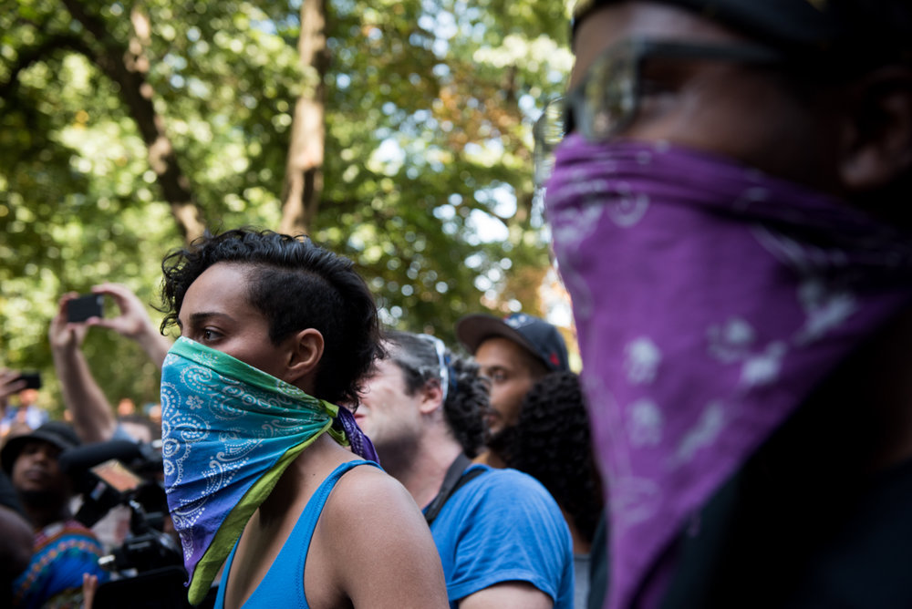 Boston, MA - 8/19/17 - A protester stands up to riot police during a protest on the Boston Common where free speech and other conservative groups clashed with an enormous counter-protest on Saturday, August 19, 2017. This day's protest occurred as part of the ongoing national outrage after protests in Charlottesville, Virginia turned deadly last weekend, primarily in opposition to what's seen as a rise in prominence and visibility of white supremacists and Neo-Nazis. (Nicholas Pfosi for The Boston Globe) Topic: 20rally photos (only)